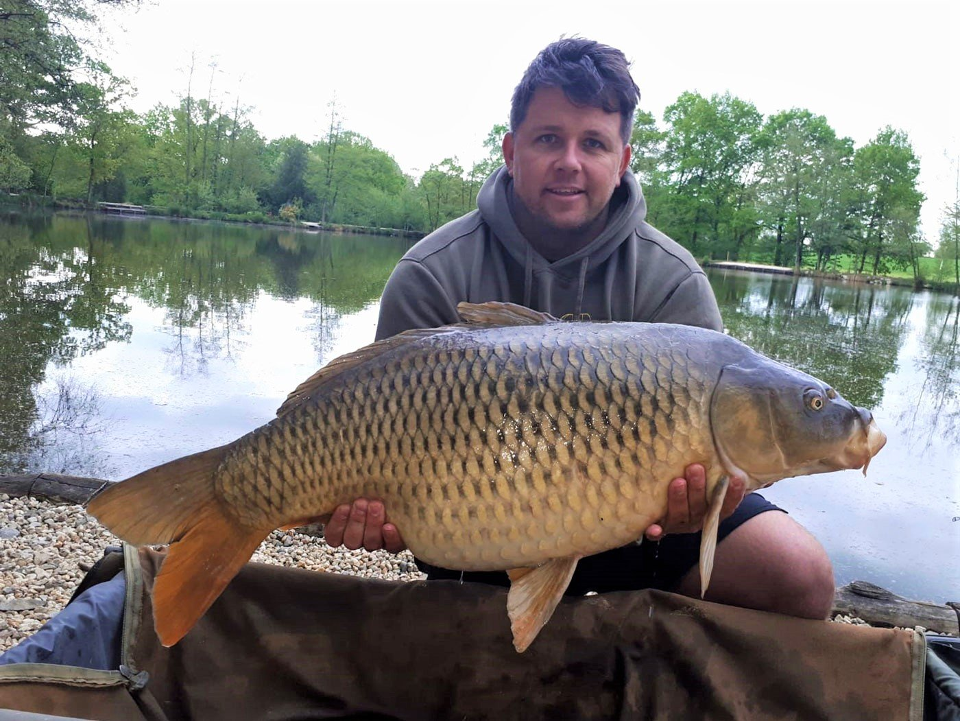 carp angler in france ben with a 36lbs common carp