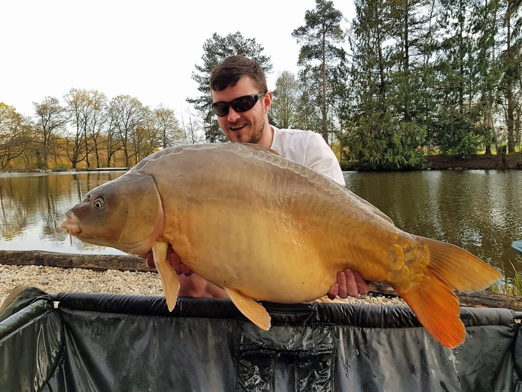 carp fishing in france angler elliot with a mirror carp of 37lbs