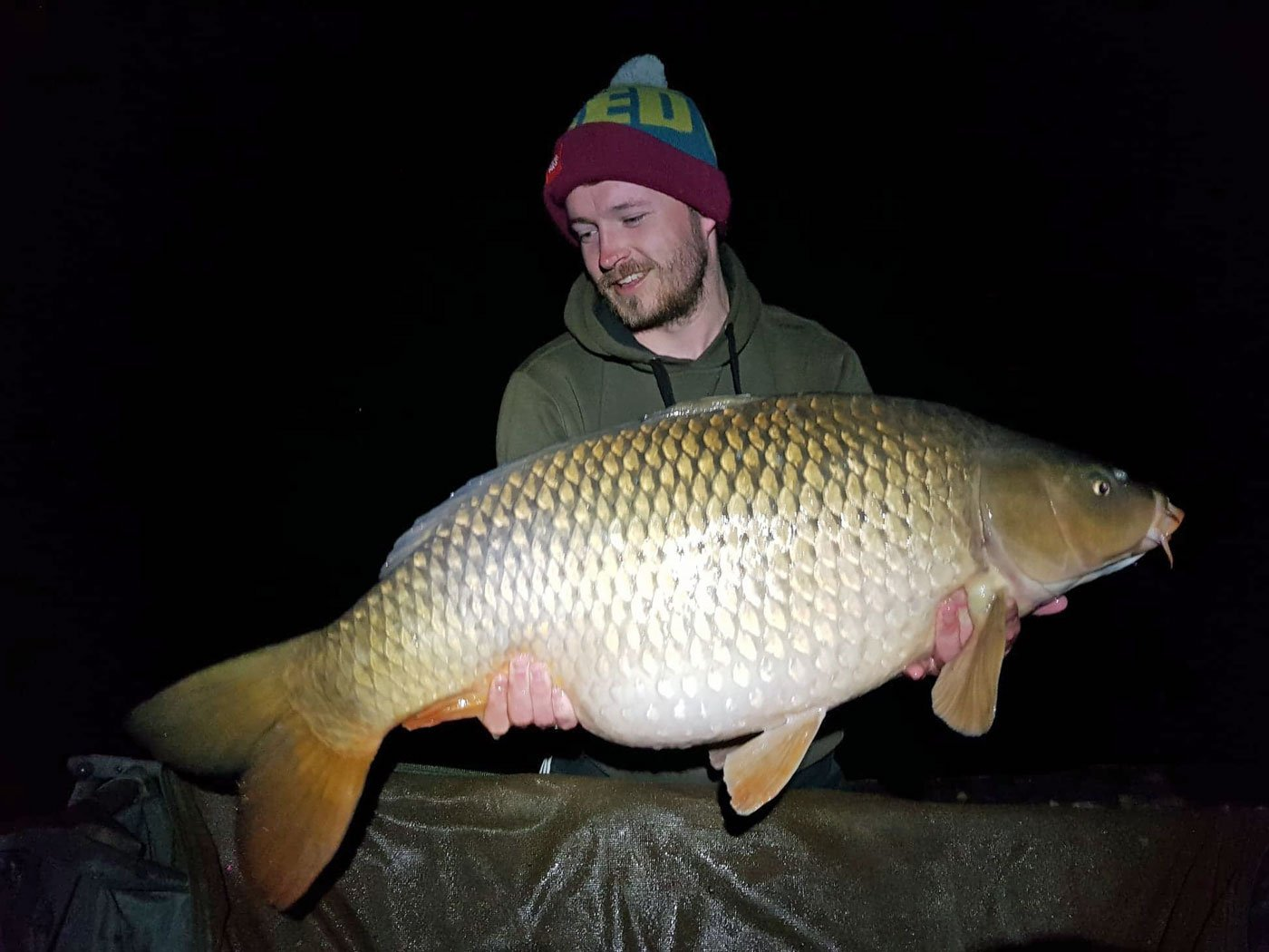 carp fishing in france angler Elliot with a common carp of 36lbs 12oz