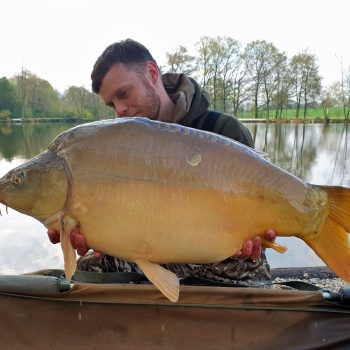 carp fishing in france angler james with a mirror carp of 35lbs