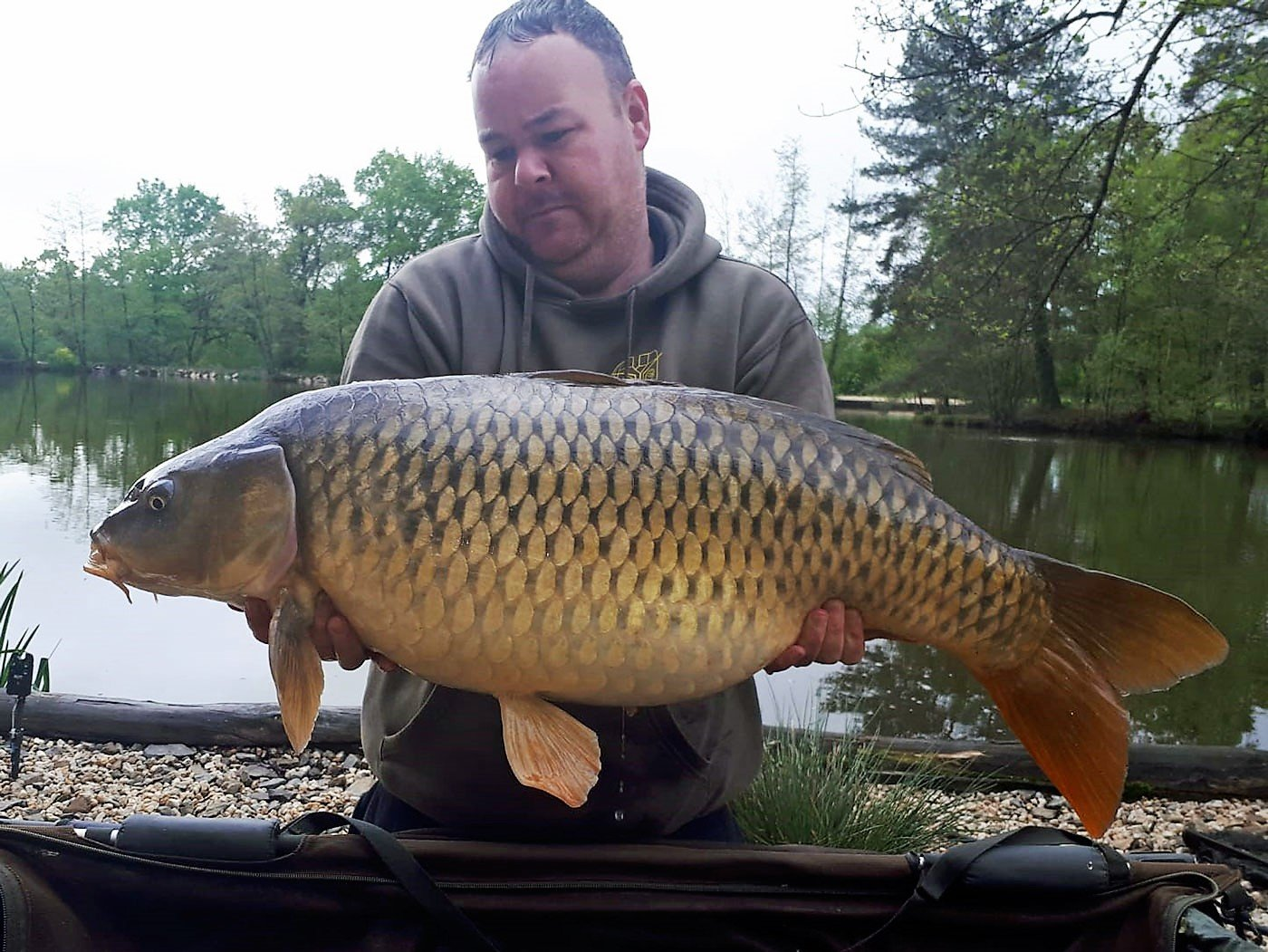 carp angler in france jay with a 30 pound common carp