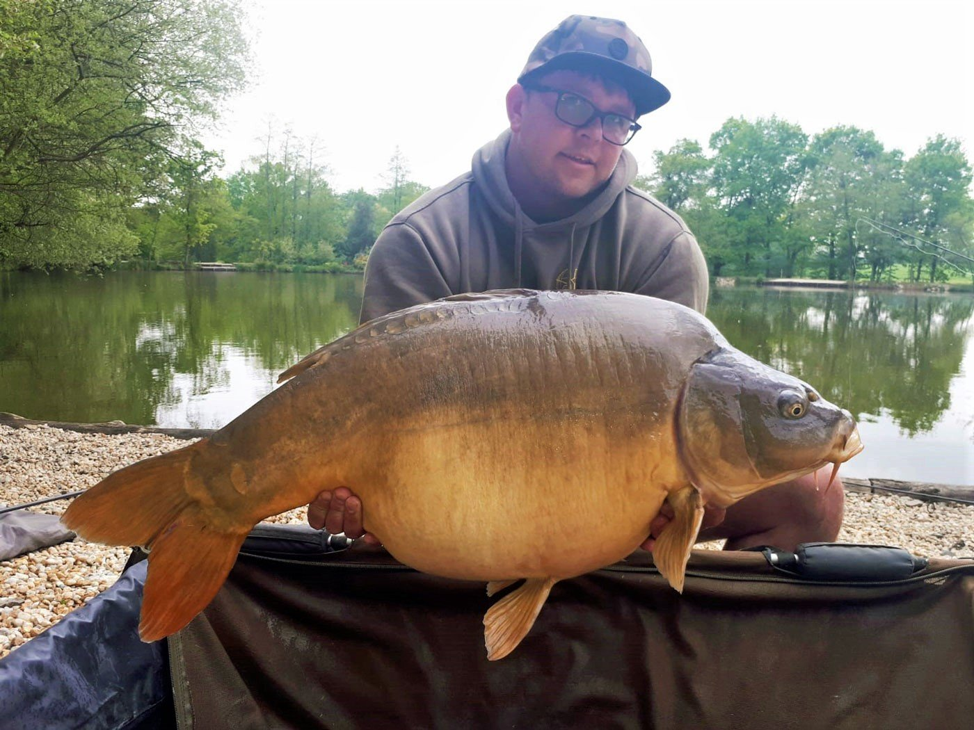 carp fishing in france ben with a mirror carp of 41lbs