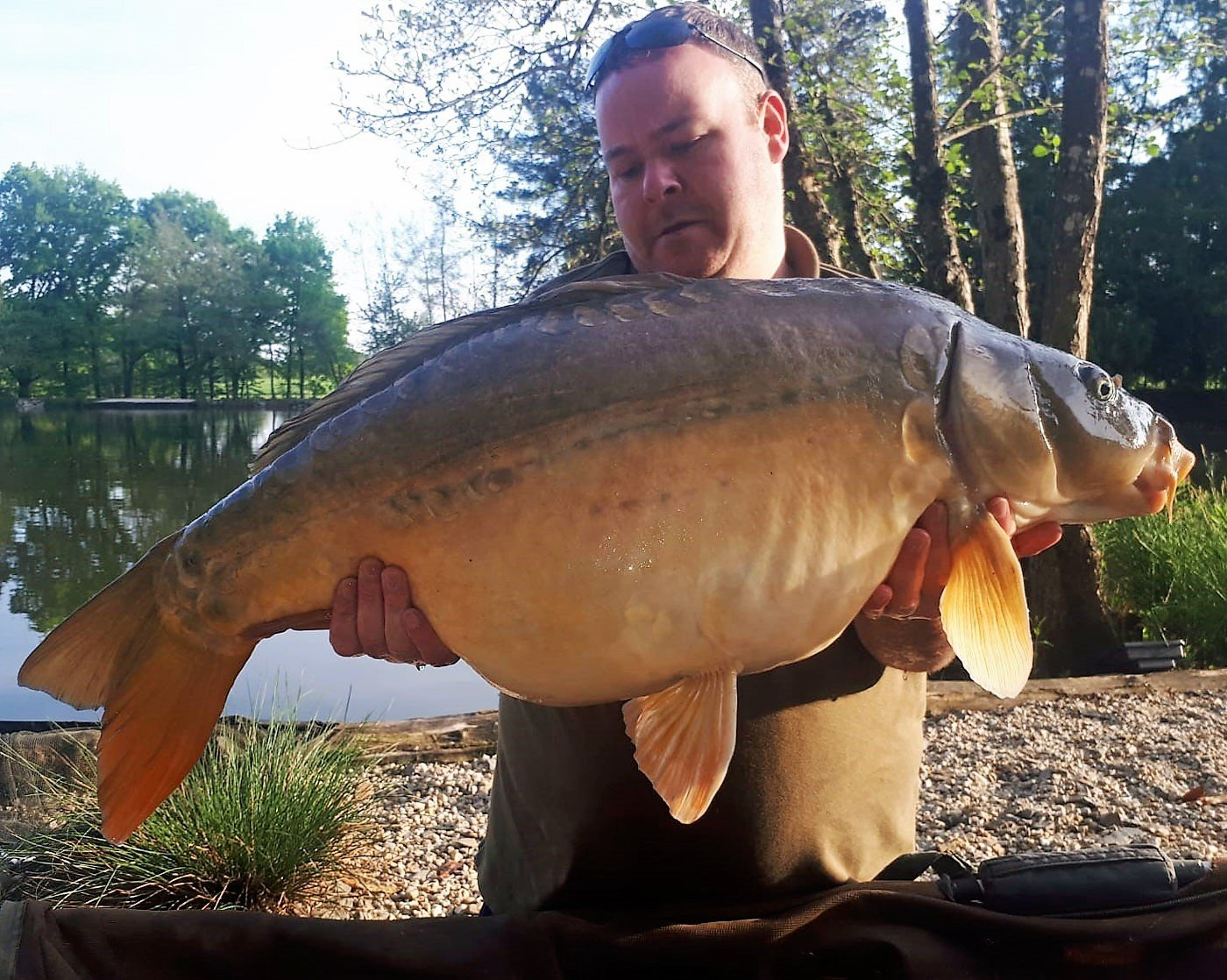 carp fishing in france jay with a mirror carp of 30lbs