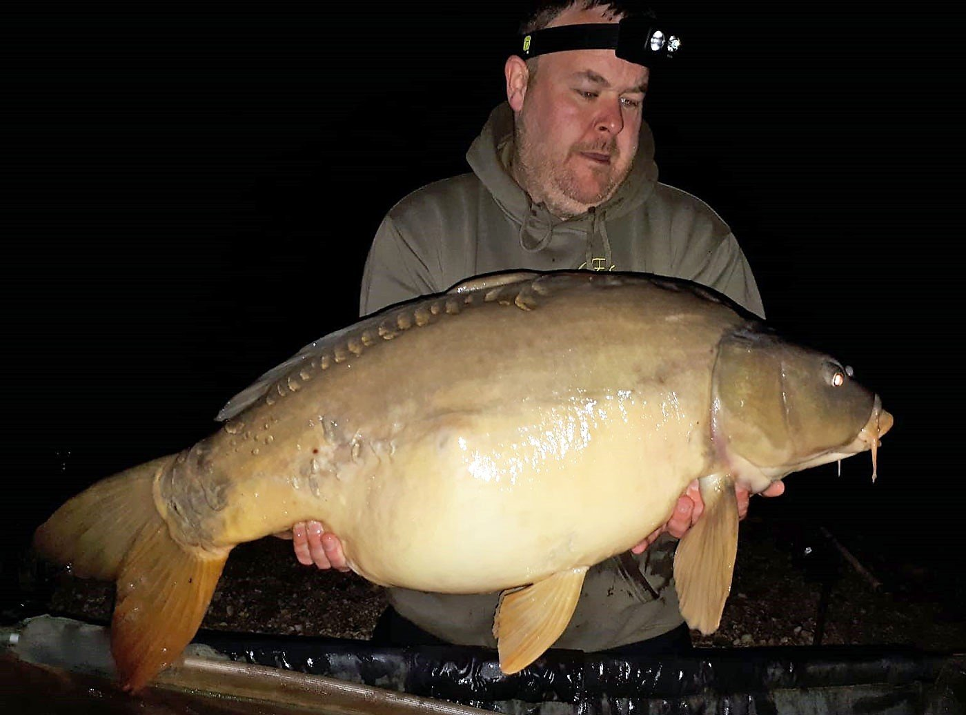 carp fishing in france jay with a mirror carp of 38lbs