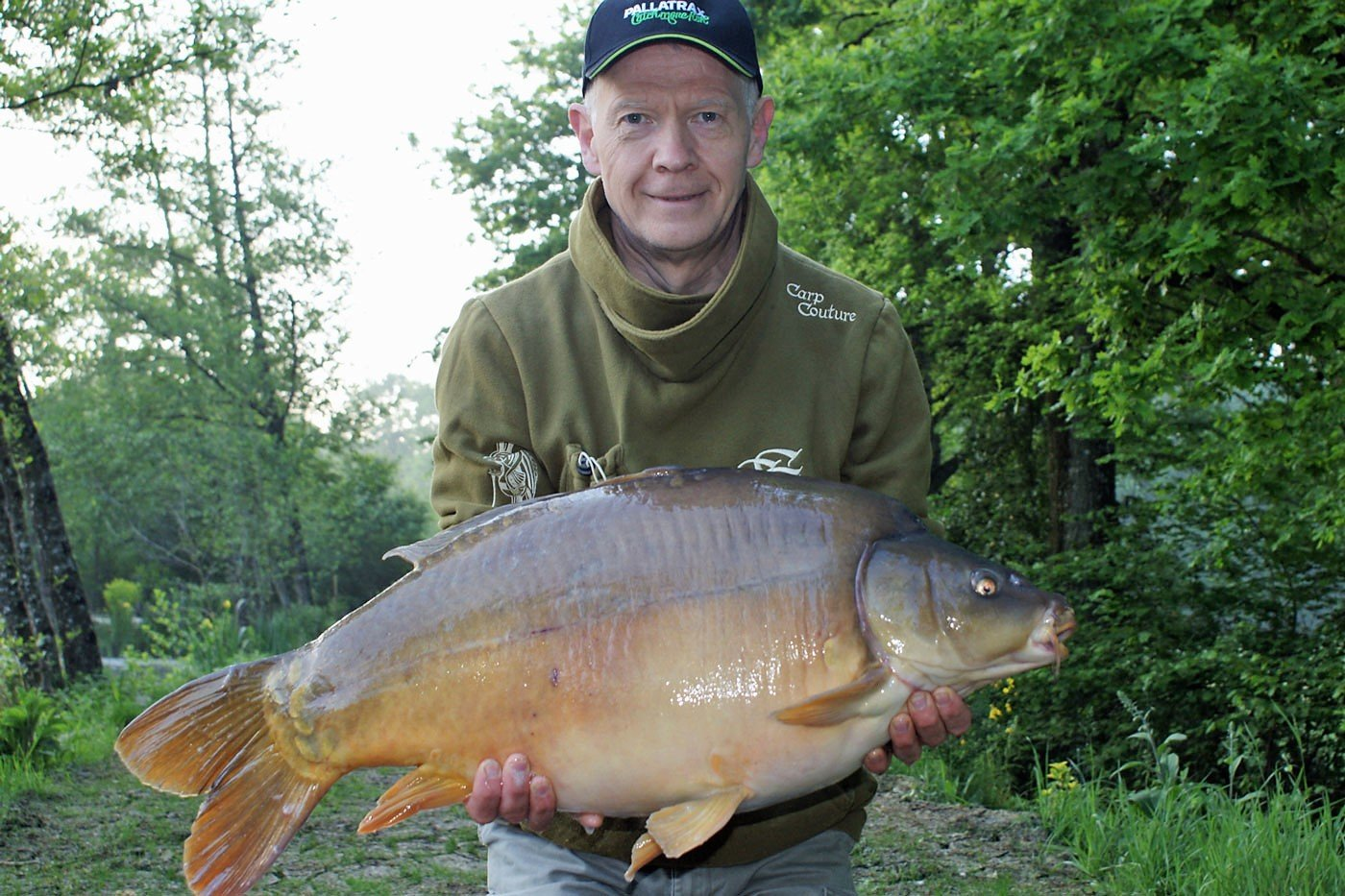 carp fishing in france angler mark with a 34lbs mirror carp