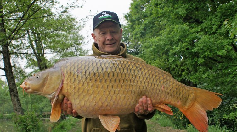 carp fishing in france angler mark with lake record common carp