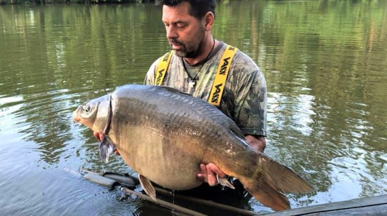 carp fishing france angler with a mirror carp of 37lbs