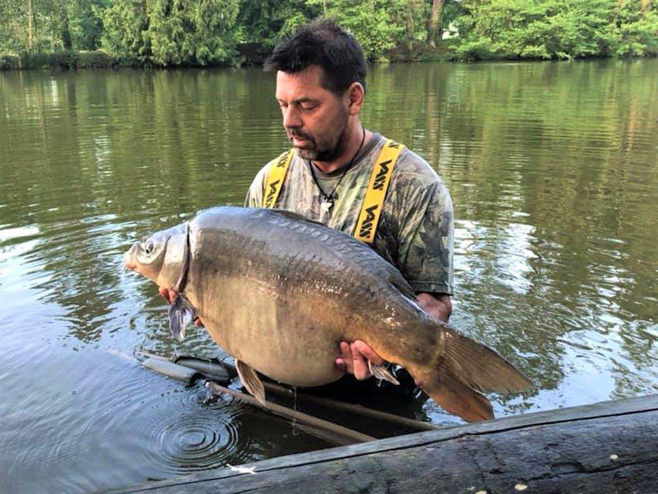 carp fishing france angler with a mirror carp of 37lbs
