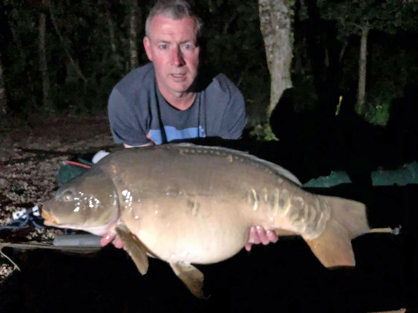 carp fishing in france shane angler with a mirror carp of 40 pounds