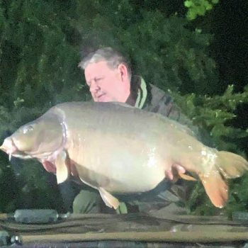tony carp fishing in france with a mirror carp od 42lbs in the middle of the night
