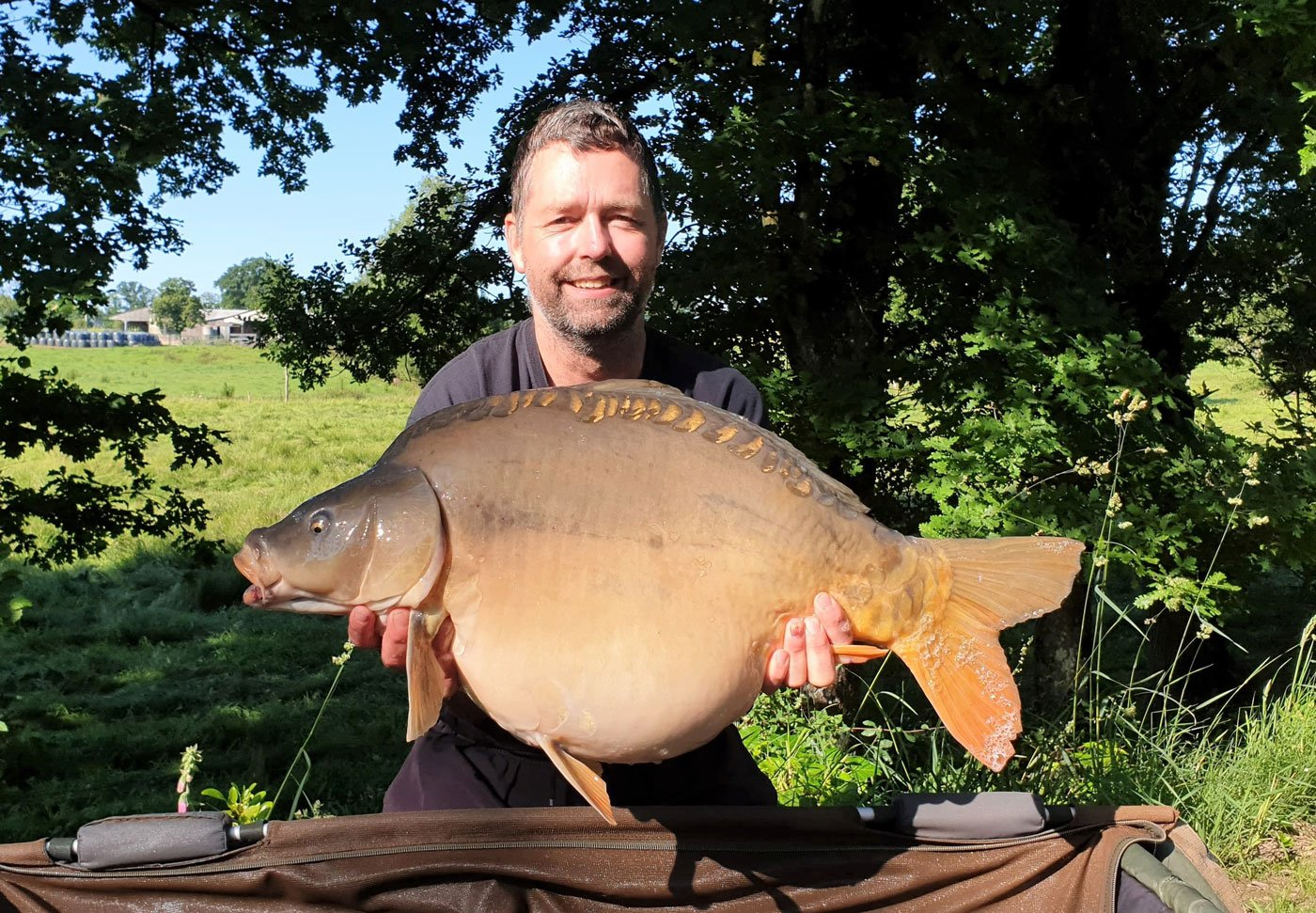 father damon carp fishing in france with a 33lbs mirror carp