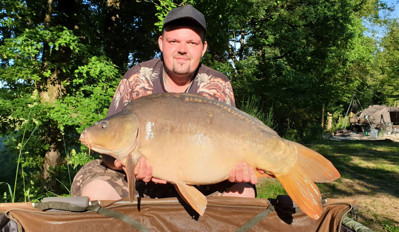 john carp fishing in france with a mirror carp of 31lbs