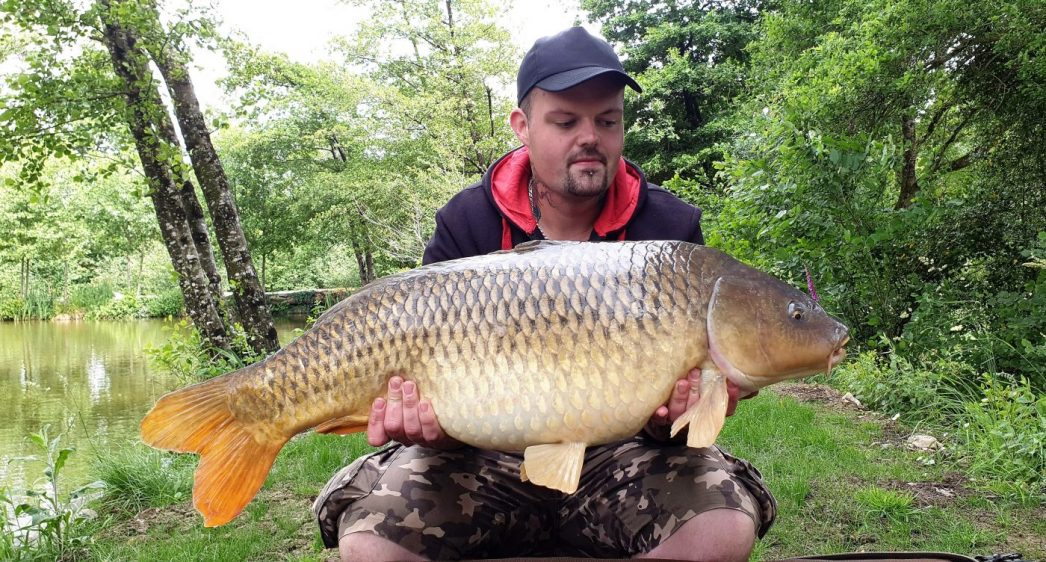john fishing for carp at a French lake with a 30lb common