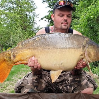 john carp fishing in france with a mirror carp of 25lbs 14oz
