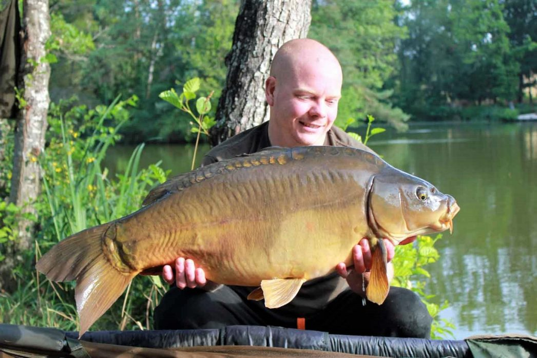 craig on a fishing holiday in france with a mirror carp of 28lbs