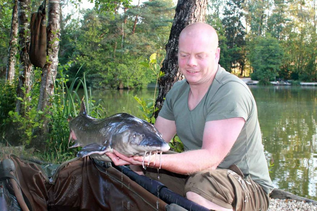 angler in france Craig with a sturgeon of 24lbs