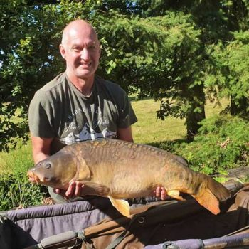 dave on a carp fishing holiday with a 29 pound carp