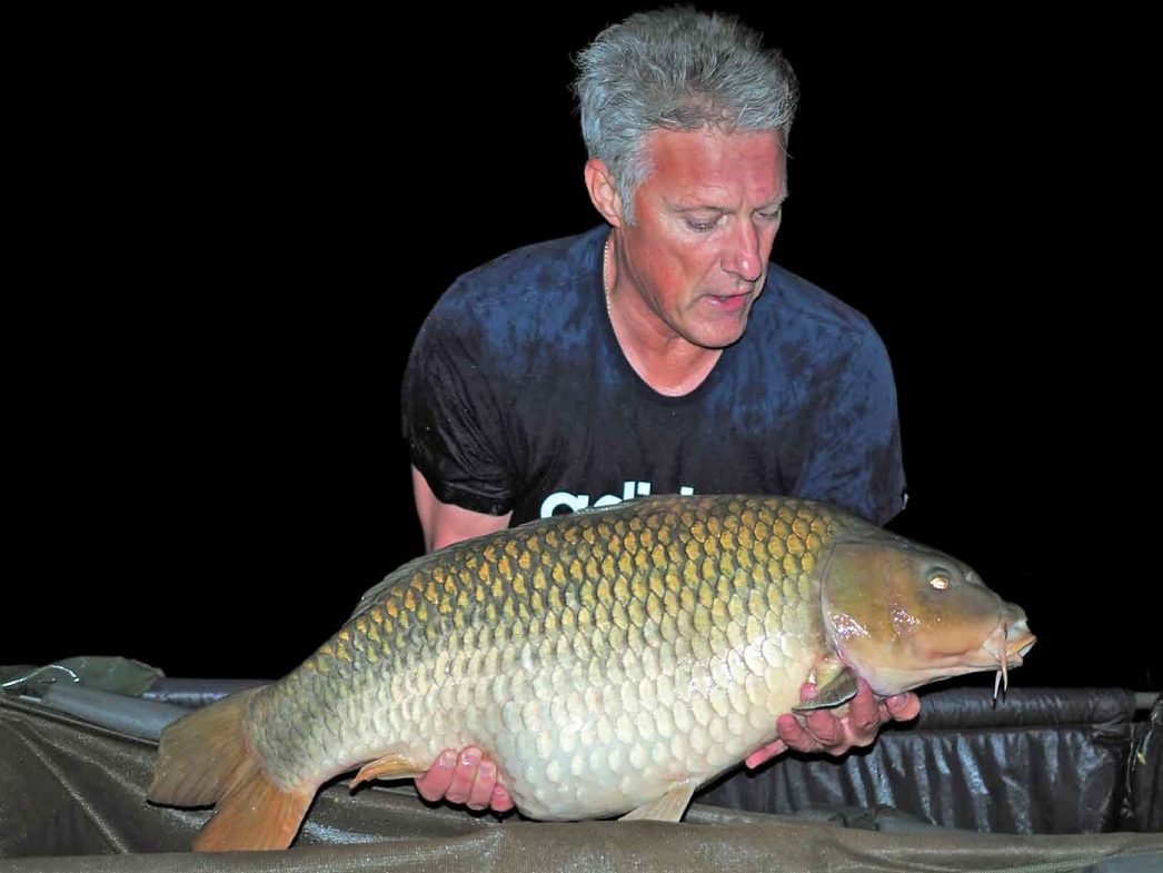 david with a common carp of 30lbs