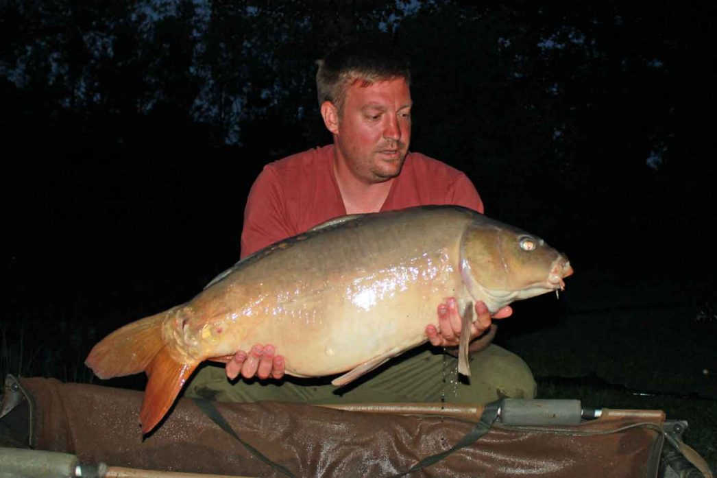 Ian with a mirror carp of 31lbs in france