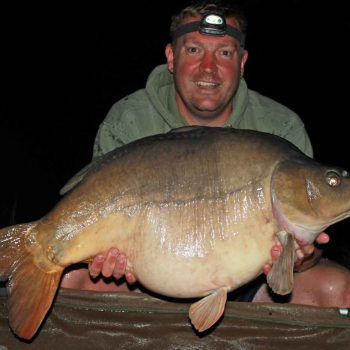 Ian with a mirror carp of 33lbs in france