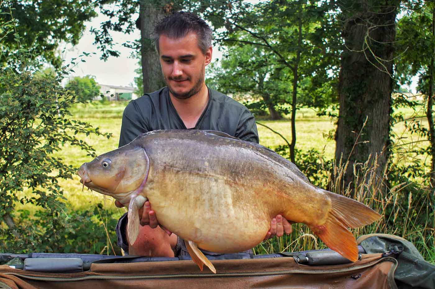 angler luke on a french carp holiday with a 37 pound carp