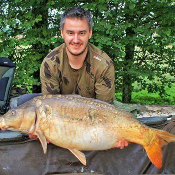 Luke with Petals at 28lbs mirror carp in france