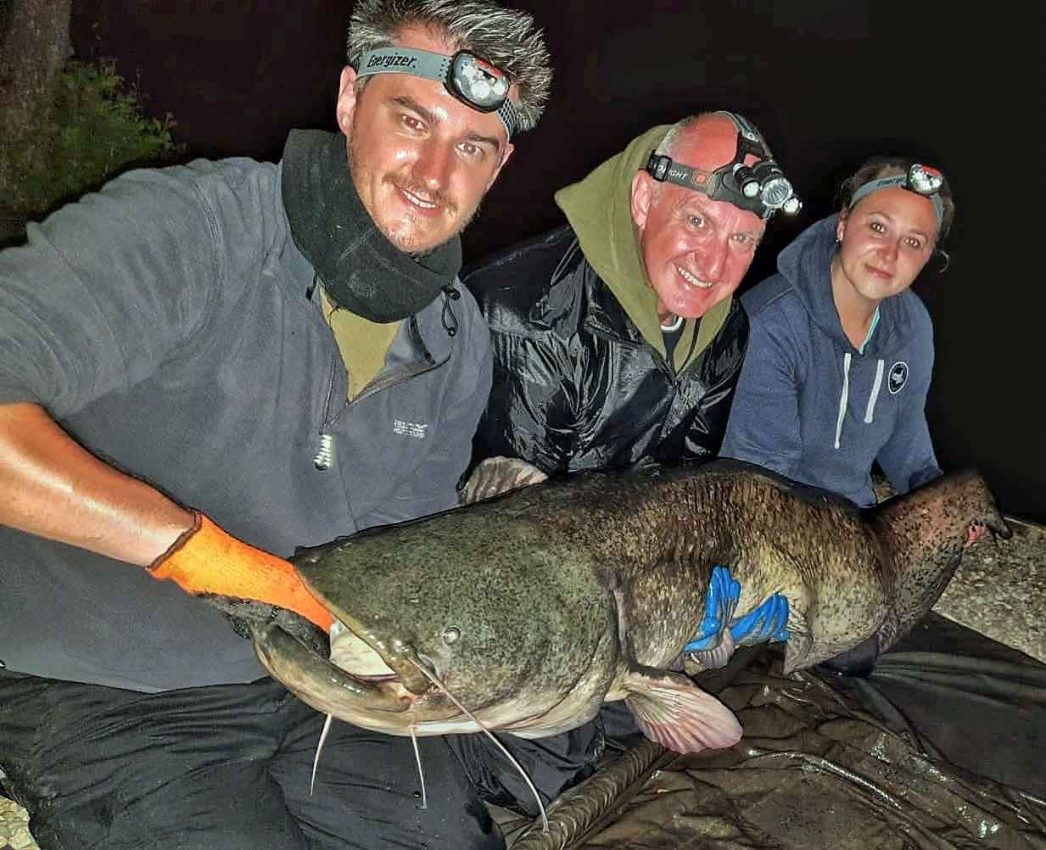 angler with a 108 pound catfish