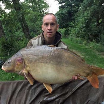 maurice on a carp fishing holiday in france with a mirror carp of 34lbs