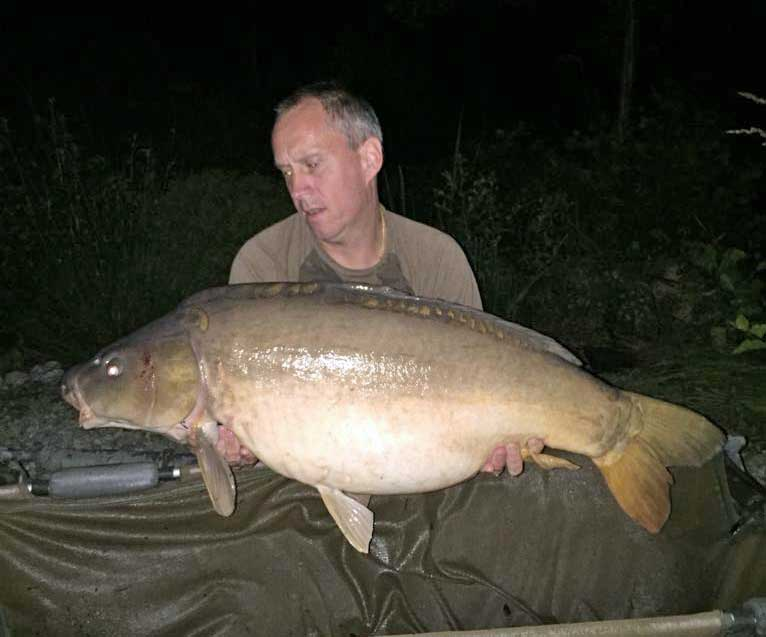 Maurice with a mirror carp of 34 pounds