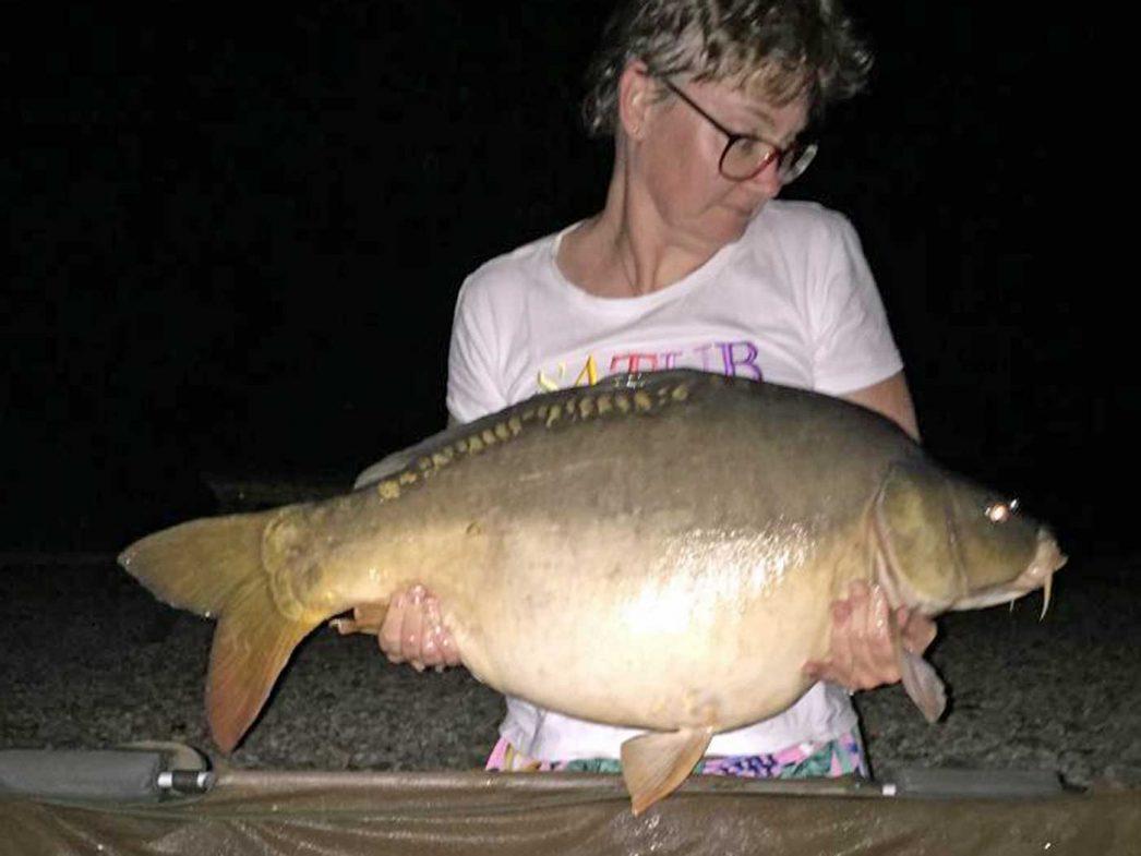 Nathalie with a 33lb mirror carp