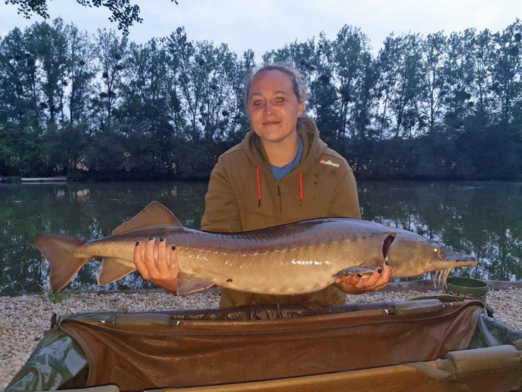 Sarah with the sturgeon at 23lbs