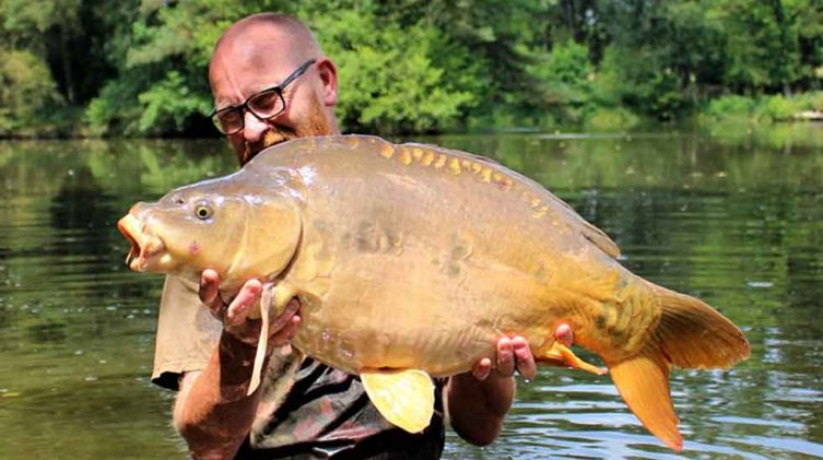 angler on carp fishing holiday in france in summer