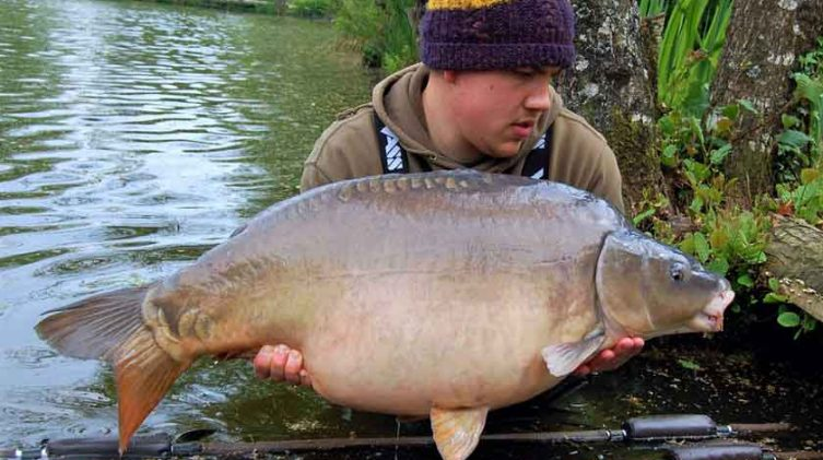 angler with big carp in france