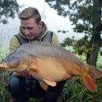 dutch angler with big mirror carp