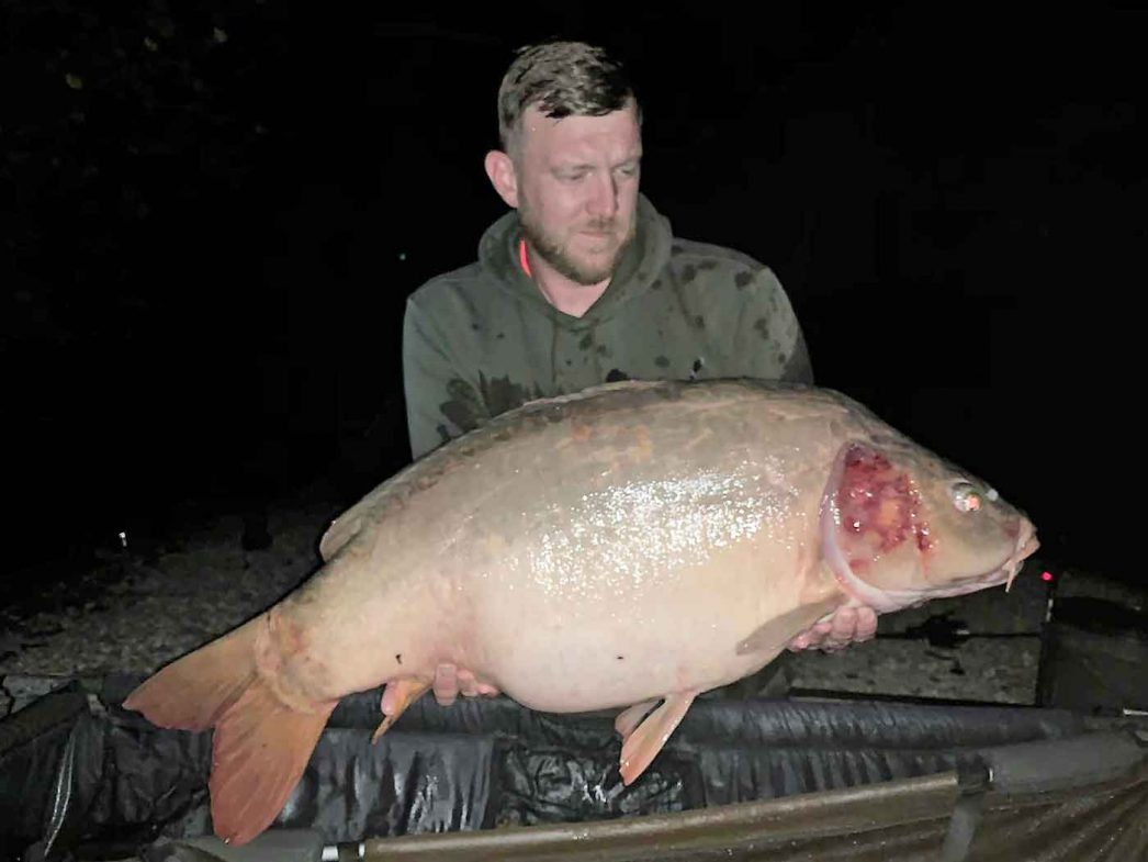 angler Dan with a mirror carp in france of 37lbs