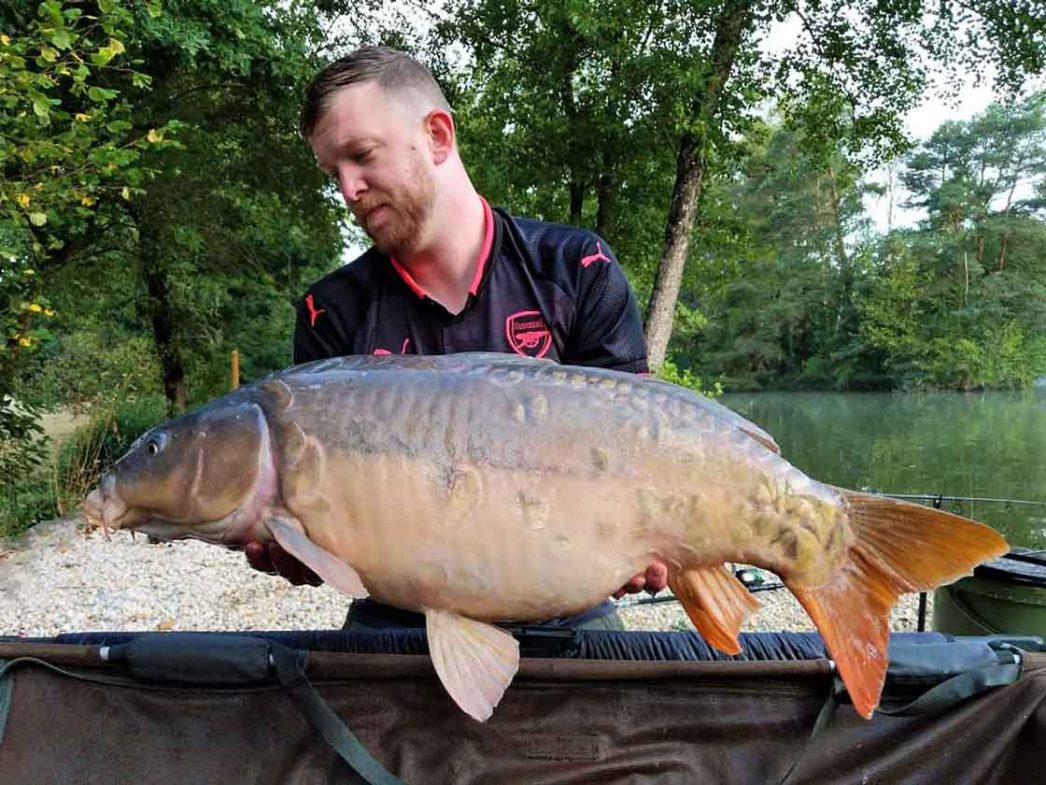 angler Dan with a mirror carp of 38lbs in france