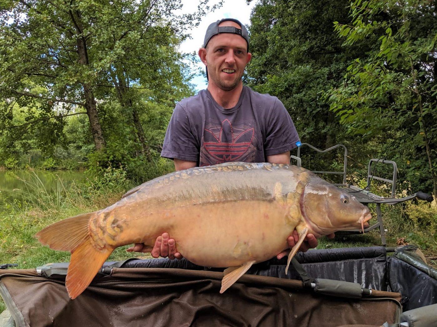 Paul with Magnum at 37lbs carp fishing holiday