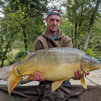 Paul with Red Dot at 26lbs carp fishing in france