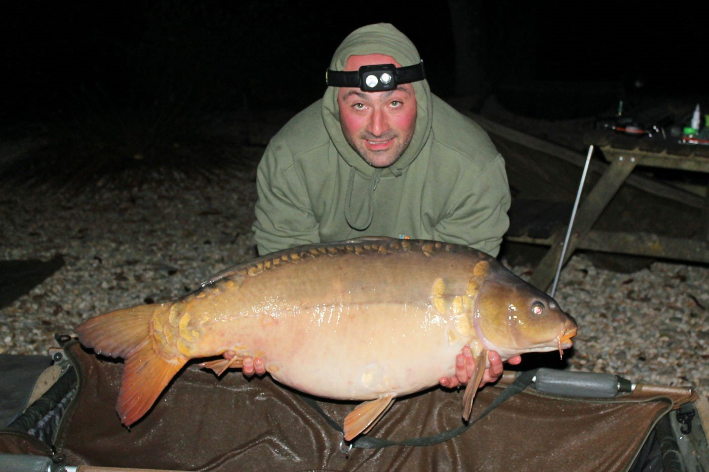 angler n france Simon with a mirror carp of 38lbs 12oz