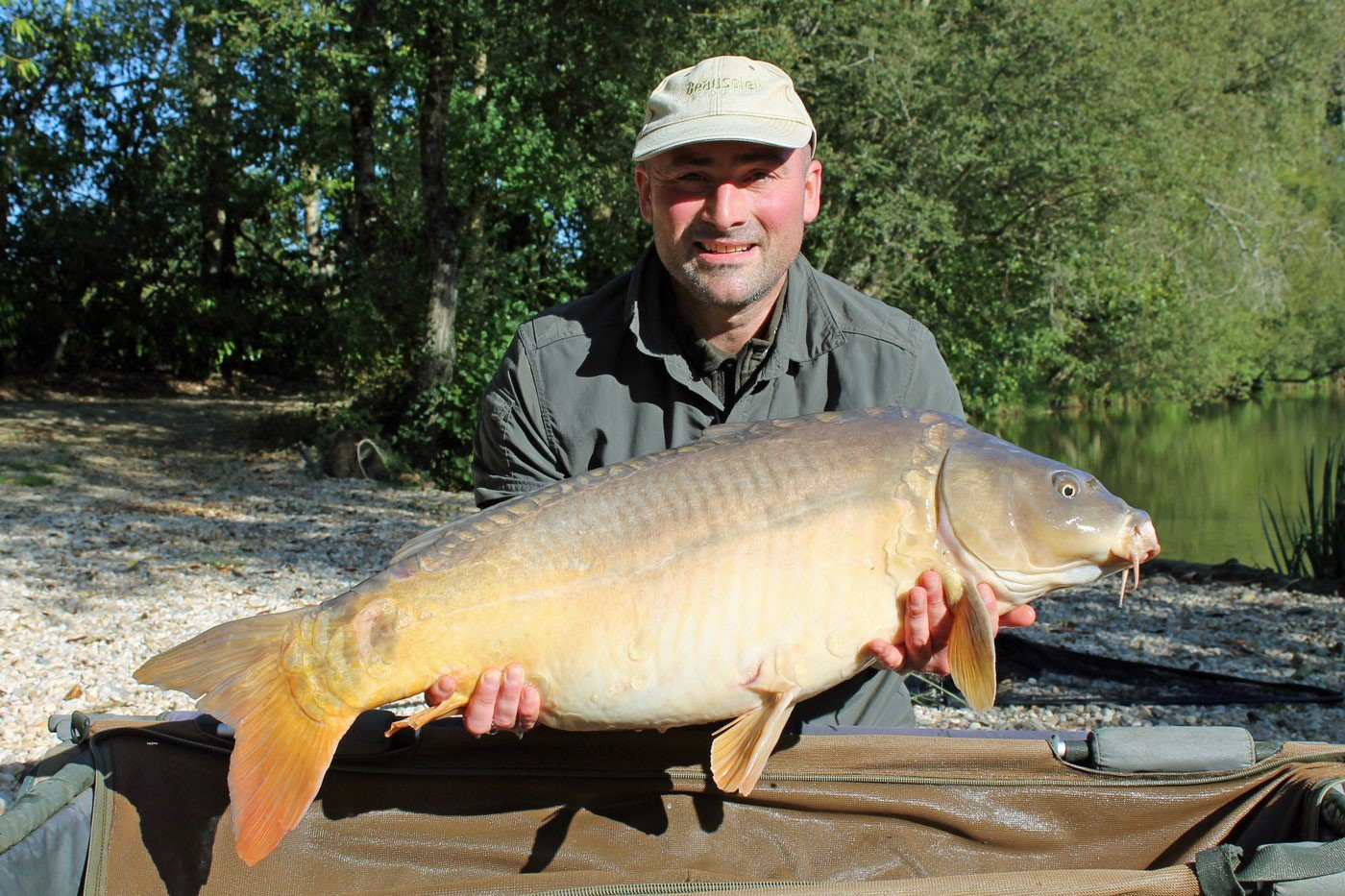 Simon with Petals a 32lb mirror carp
