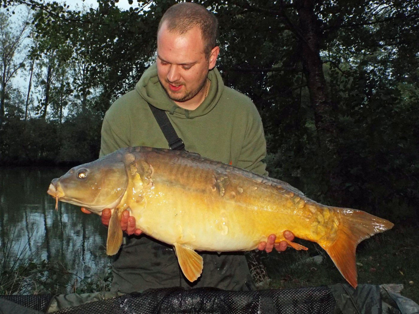 Andy with Petals at 31lbs 8oz a mirror carp
