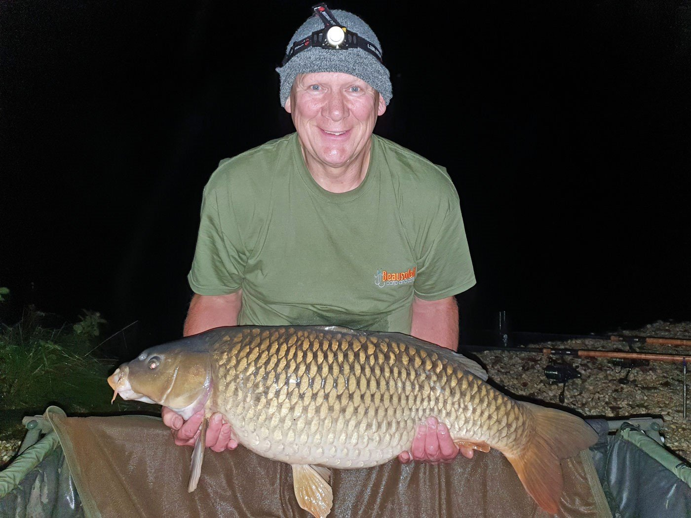 angler with a common carp of 29lbs 8oz