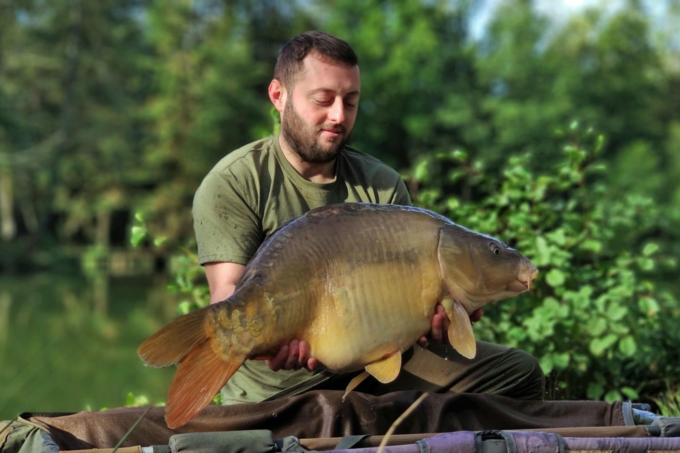 carp angler dan with a 28lb mirror carp